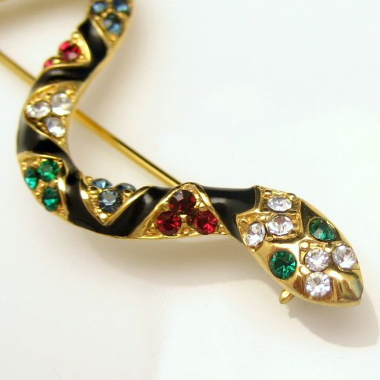 Large Vintage Black Enamel Red Blue Green Rhinestones Snake Brooch from myclassicjewelry.com